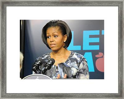 Michelle Obama Presents The Childhood Framed Print by Everett