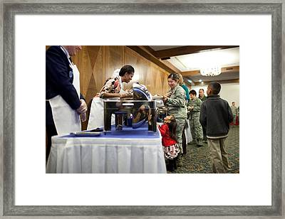 Michelle Obama Talks With A Little Girl Framed Print