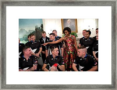 Michelle Obama Talks With Participants Framed Print by Everett
