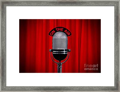 Microphone On Stage With Spotlight On Red Curtain Framed Print by Richard Thomas