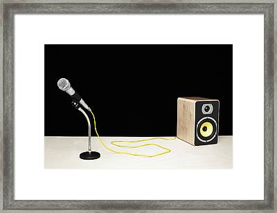 Microphone With Yellow Cable Plugged Into Speaker Framed Print by Microzoa