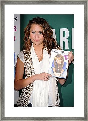 Miley Cyrus At In-store Appearance Framed Print by Everett