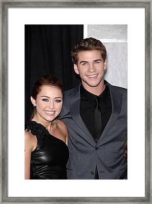 Miley Cyrus, Liam Hemsworth At Arrivals Framed Print