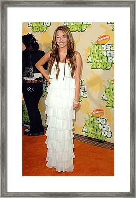 Miley Cyrus Wearing A Sheri Bodell Gown Framed Print