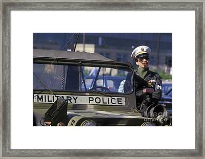 Military Policeman Stands Next Framed Print