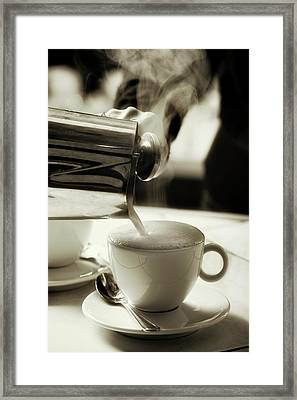 Milk Steaming Jug Adding Hot Milk To A Coffee Cup Framed Print by Andrew Bret Wallis
