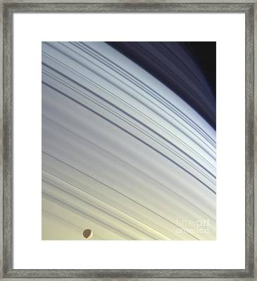 Mimas Drifts Along In Its Orbit Framed Print by Stocktrek Images