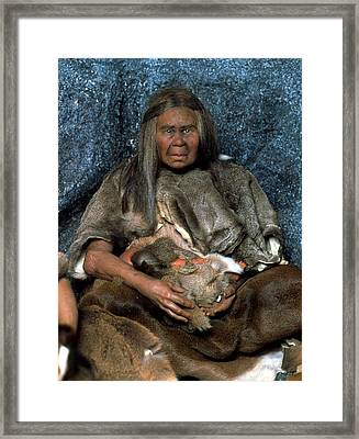Model Of A Neanderthal Woman Holding A Baby Framed Print