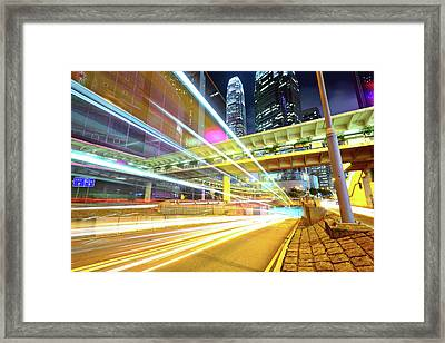 Modern City At Night Framed Print by Leung Cho Pan