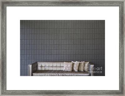 Modern Sofa Against A Brick Wall Framed Print
