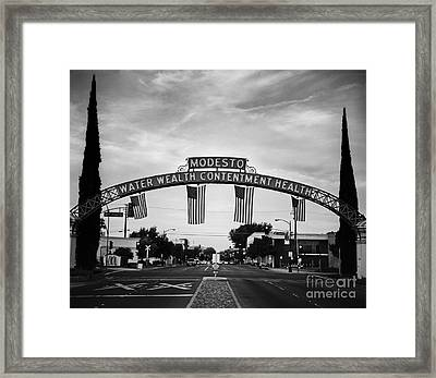Modesto Arch With Flags Framed Print by Jim and Emily Bush