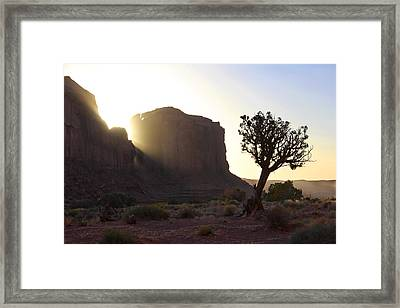 Monument Valley At Sunset Framed Print by Mike McGlothlen
