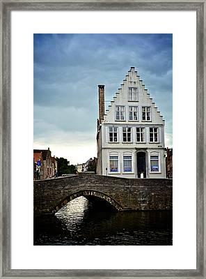 Moody Bruges Framed Print