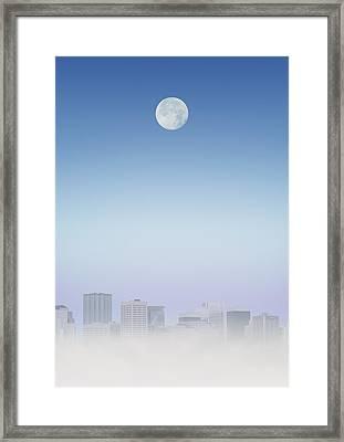 Moon Over Buildings Framed Print by Kelly Redinger