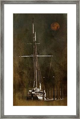Moon Over Masts Framed Print