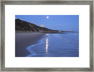 Moon Reflecting In The Sea, Bournemouth Beach, Dorset, England, Uk Framed Print by Peter Lewis