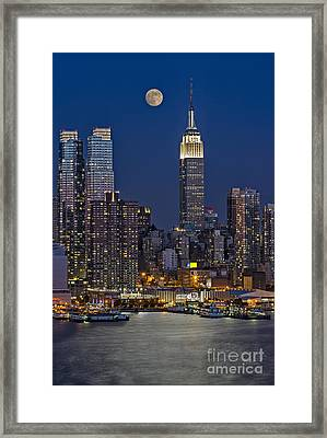 Moonrise Along The Empire State Building Framed Print by Susan Candelario