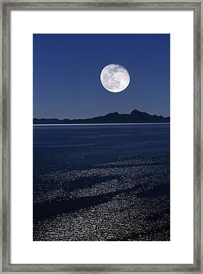 Moonrise Over Sea Framed Print by David Nunuk