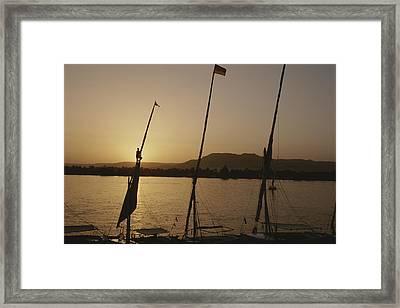 Moored Feluccas On The Nile River Framed Print by Kenneth Garrett