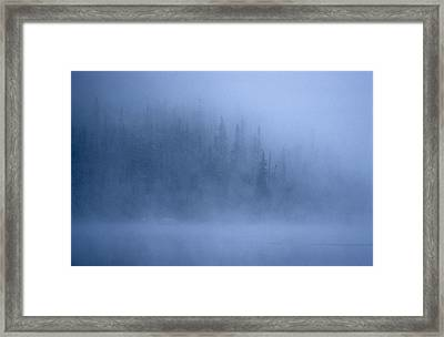 Morning Mist Rises Off A Lake Framed Print by Kenneth Ginn
