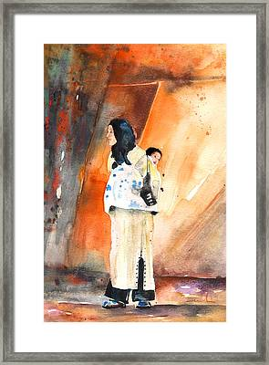 Moroccan Woman Carrying Baby Framed Print by Miki De Goodaboom