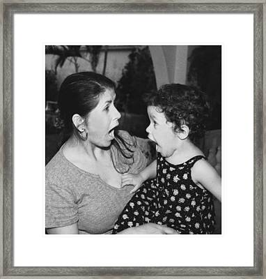 Mother And Child Framed Print by Miguel Capelo