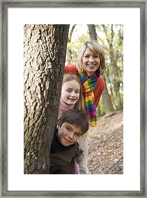 Mother And Children Playing In A Wood Framed Print
