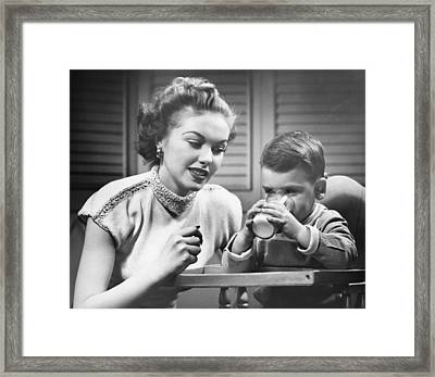 Mother Assisting Son (2-3) Drinking Milk, (b&w) Framed Print by George Marks