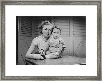 Mother Embracing Son (2-3) Indoors, Portrait Framed Print by George Marks