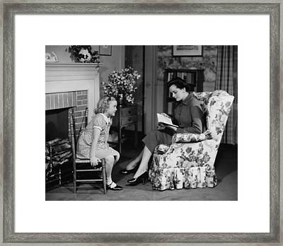 Mother Reading To Daughter (6-7) In Living Room, (b&w) Framed Print