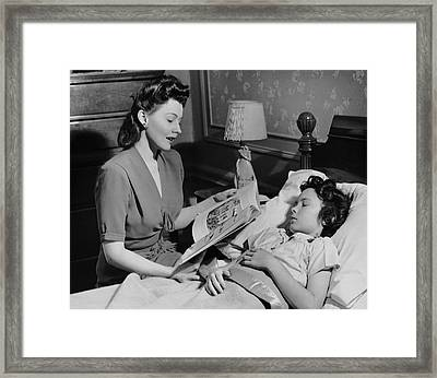 Mother Reads Child A Bedtime Story Framed Print by George Marks