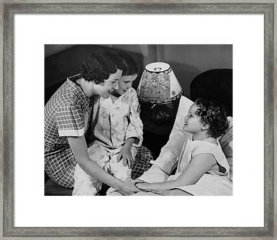 Mother Sitting W/children At Bedtime Framed Print by George Marks