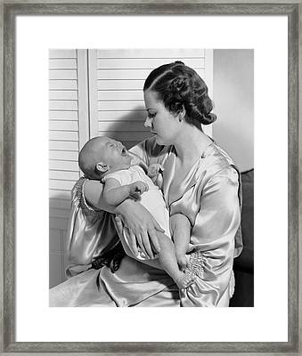 Mother W/ Baby Yawning Framed Print by George Marks