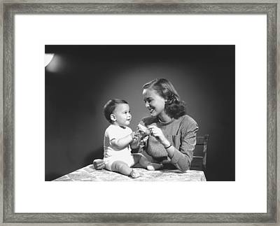 Mother With Baby (6-9 Months) Playing At Home, (b&w) Framed Print by George Marks