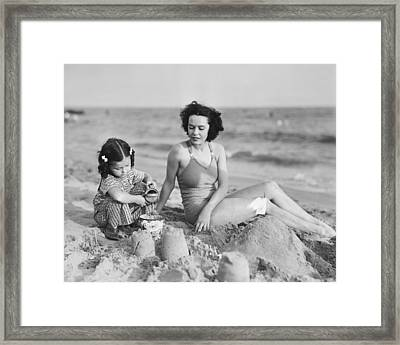 Mother With Girl (2-3) Playing In Sand On Beach, (b&w) Framed Print