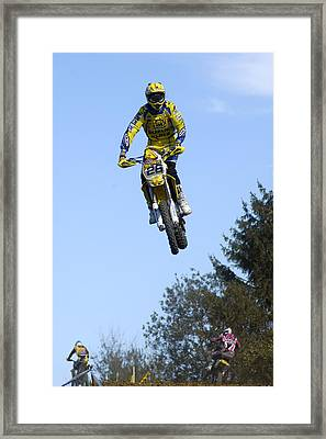 Motocross Rider Jumping High Framed Print by Matthias Hauser