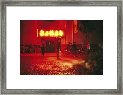 Motorcyclists Outside A Karaoke Bar Framed Print by Justin Guariglia