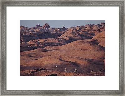 Mountain Bike Riders On Slickrock Trail Framed Print by Joel Sartore