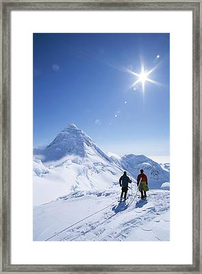 Mountain Climbers Contemplate A Distant Framed Print by John Burcham