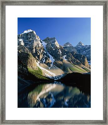 Mountains Reflected In Moraine Lake, Canada Framed Print
