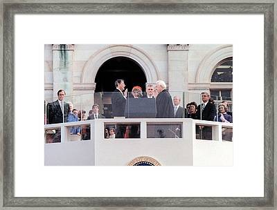 Mrs. Reagan Holds The Bible As Ronald Framed Print by Everett