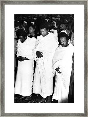 Muhammad Ali Praying In The Holy Mosque Framed Print by Everett