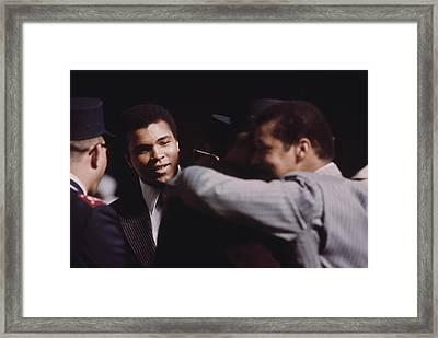 Muhammad Ali Talks With Fellow Black Framed Print