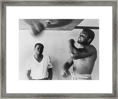 Muhammad Ali, Works Out On Light Bag Framed Print