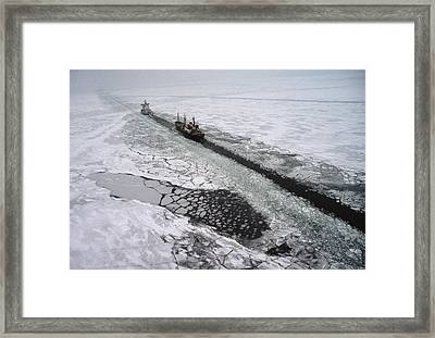 Multinational Fleet Of Icebreakers Framed Print by Cotton Coulson