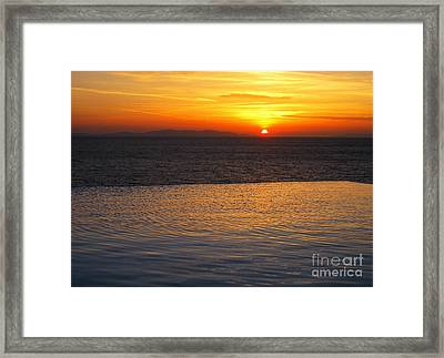 Mykonos Sunset Framed Print by Leslie Leda