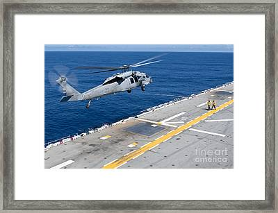 N Mh-60s Sea Hawk Helicopter Lifts Framed Print
