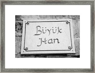nameplate on the exterior of buyuk han the great inn in nicosia TRNC turkish cyprus Framed Print by Joe Fox