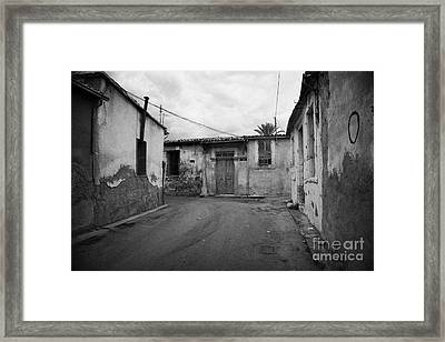 narrow run down city streets in northern nicosia TRNC turkish republic of northern cyprus Framed Print by Joe Fox