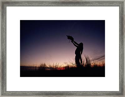 Native North American Holding An Framed Print by Chris Johns